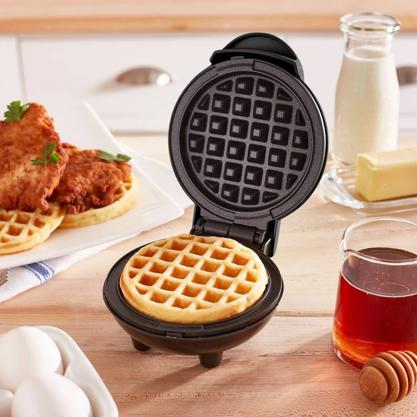 A mini waffle maker in a kitchen