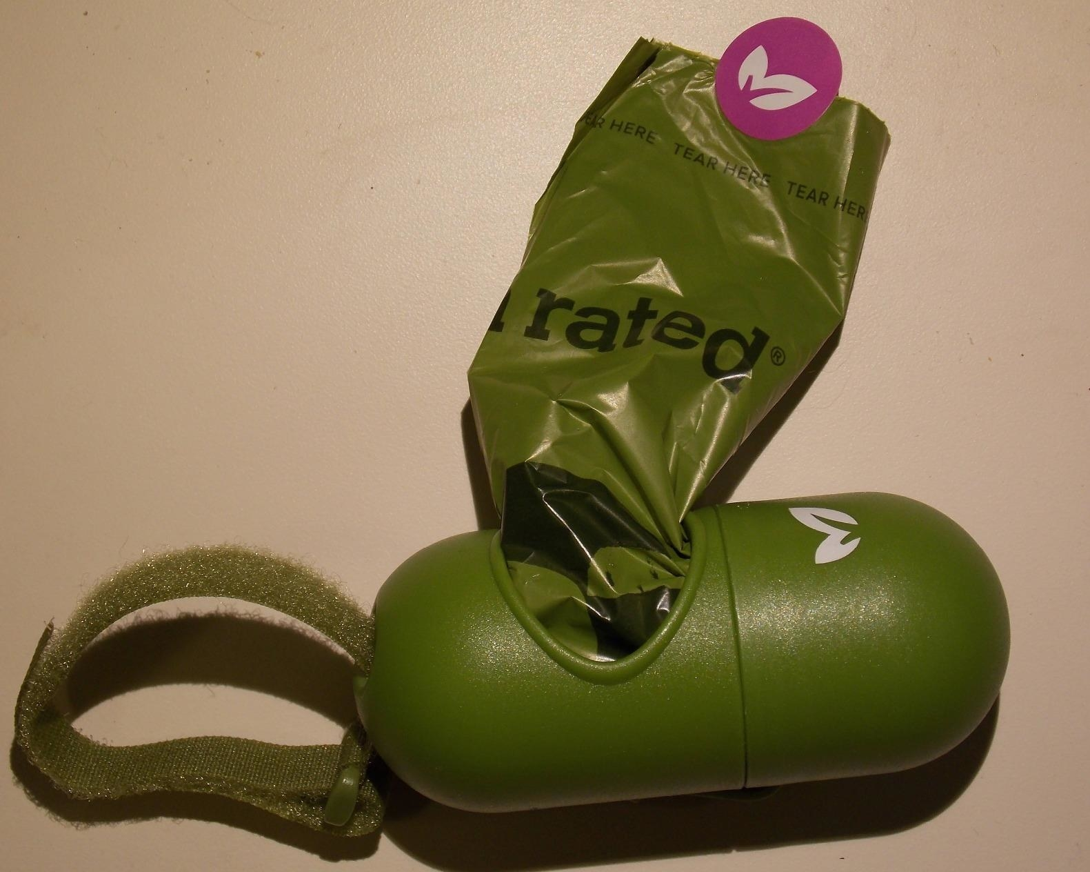 Reviewer's photo of the poop bag dispenser