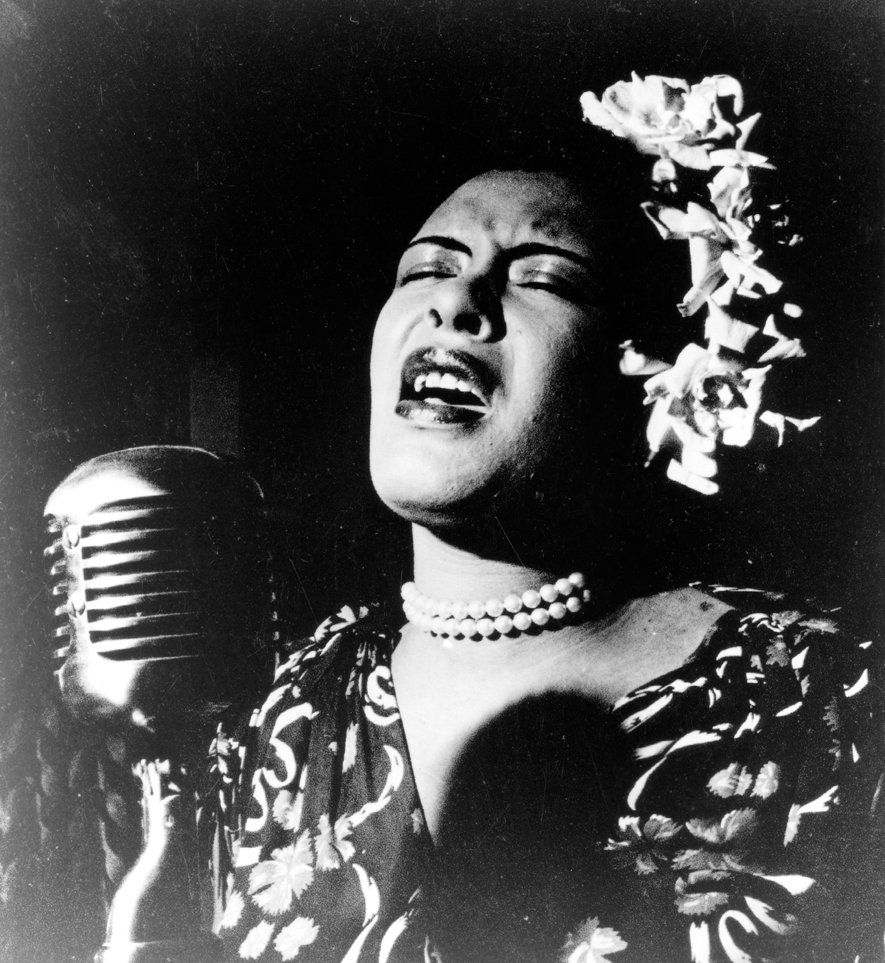 Billie holiday singing into microphone