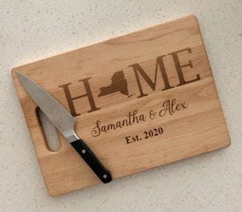 a wooden cutting board that says