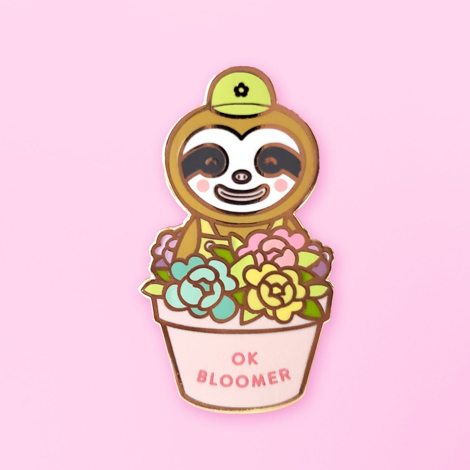 "a sloth character from animal crossing in a flower pot that says ""ok bloomer"" on it"