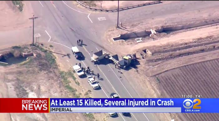 Two crushed vehicles are pictured near an intersection.