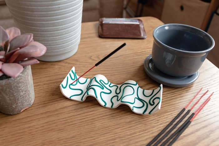 the white and teal curved incense holder
