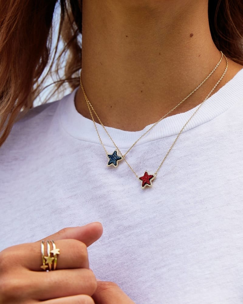 a model wearing two necklaces with star druzy charms