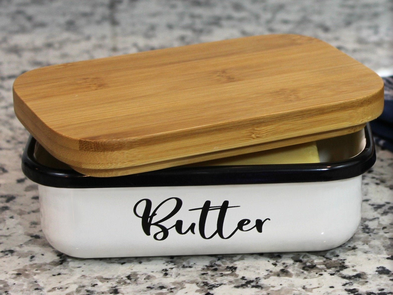 Butter dish open with butter inside