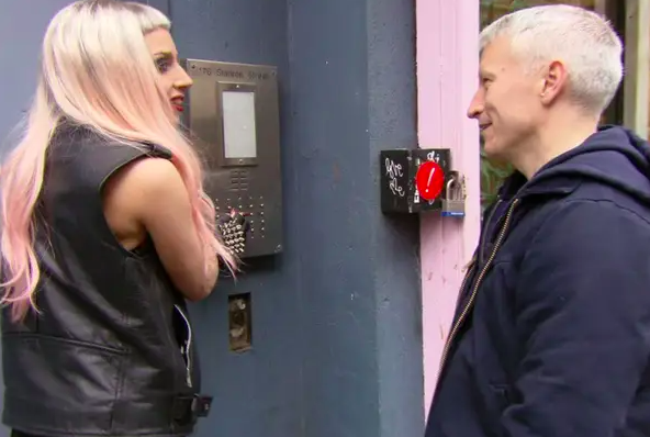 Lady Gaga about to enter her apartment building with Anderson Cooper