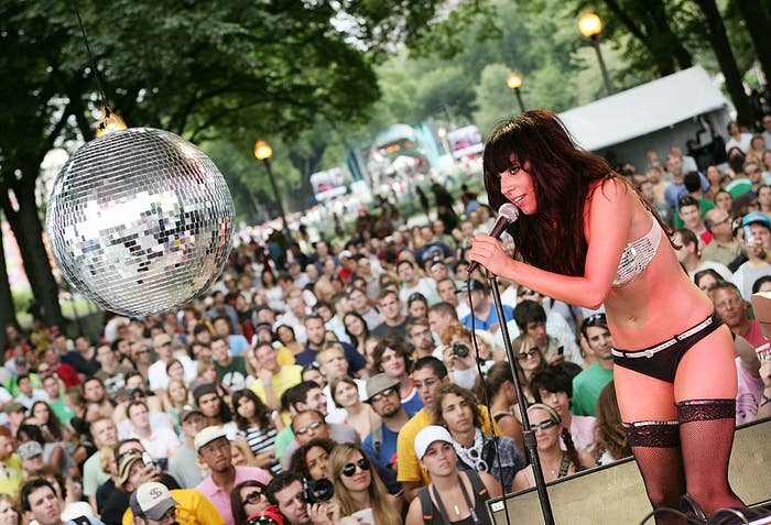 Pre-famous Lady Gaga performing in front of a crowd during an outdoors concert