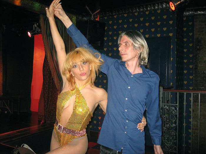 Stefani wearing a bedazzled leotard and dancing with a man