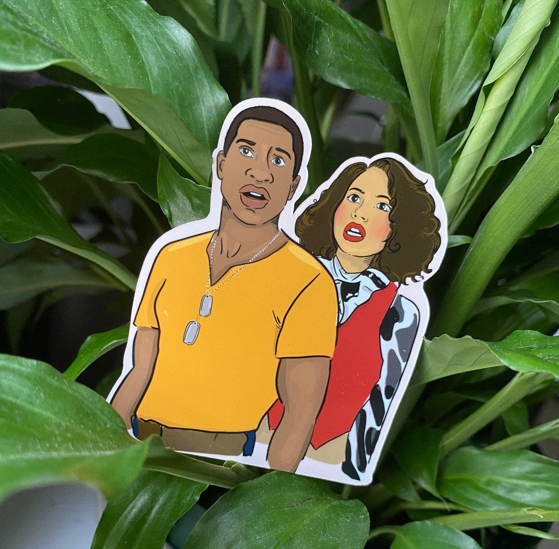 sticker of illustrated characters Letitia and Atticus from Lovecraft Country