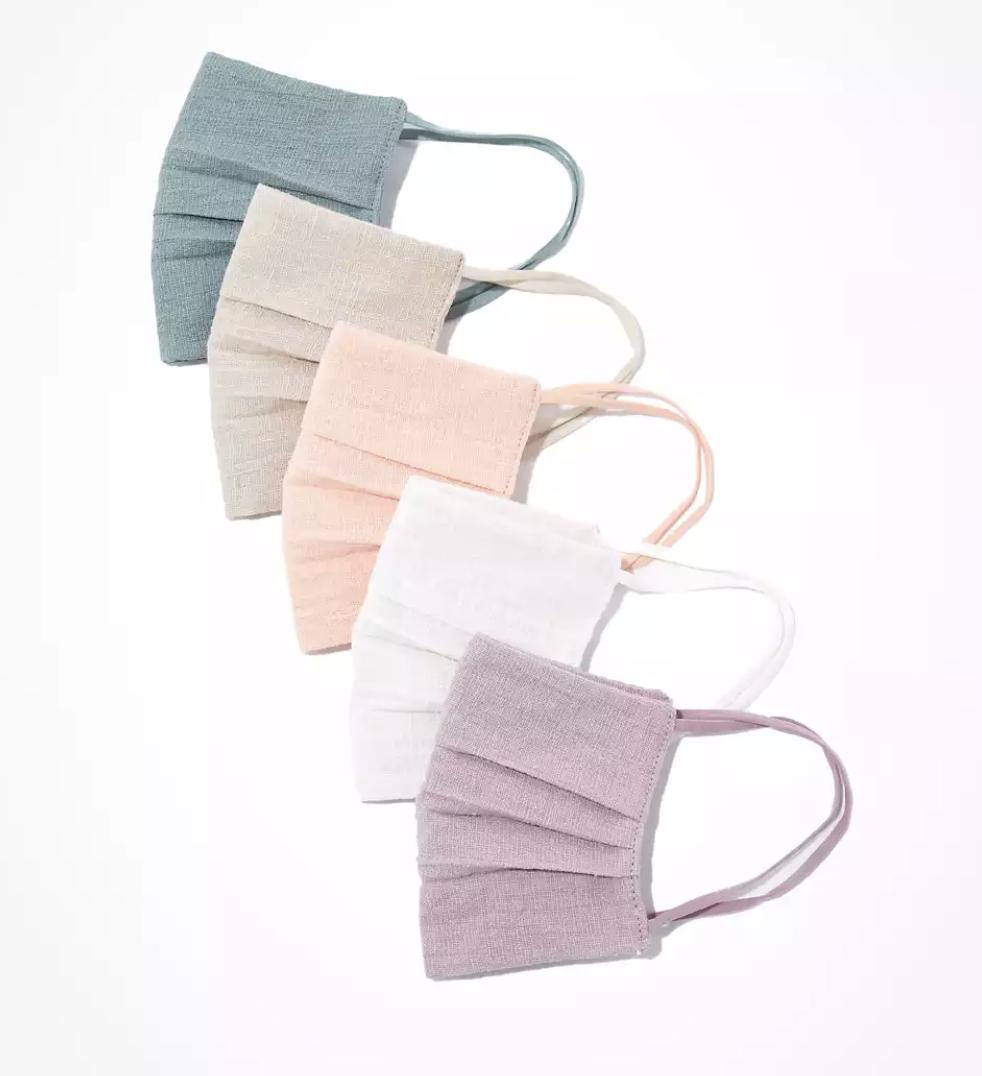 Five linen face masks in pastel colors