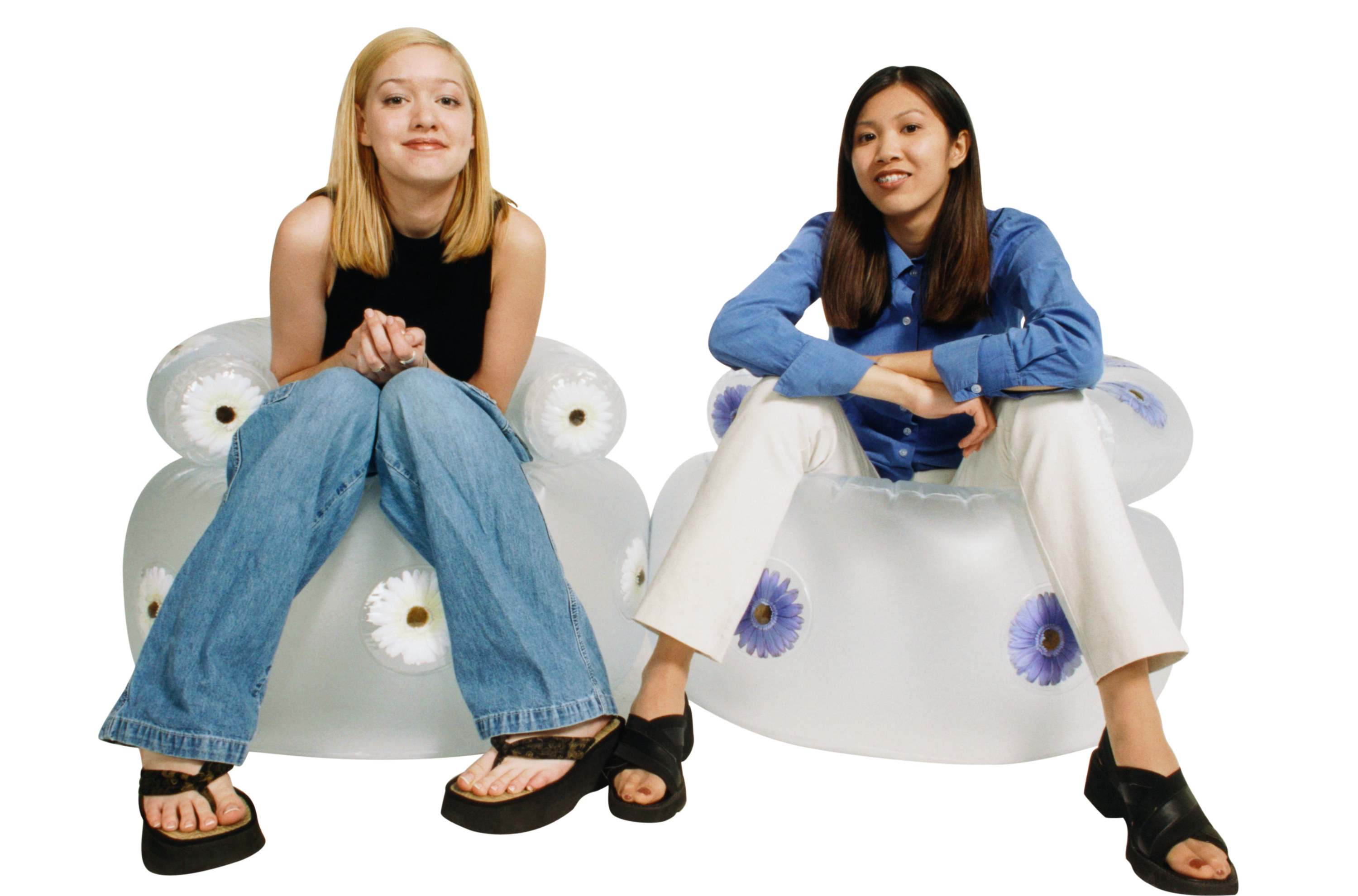 Two people from the '90s sitting in inflatable chairs