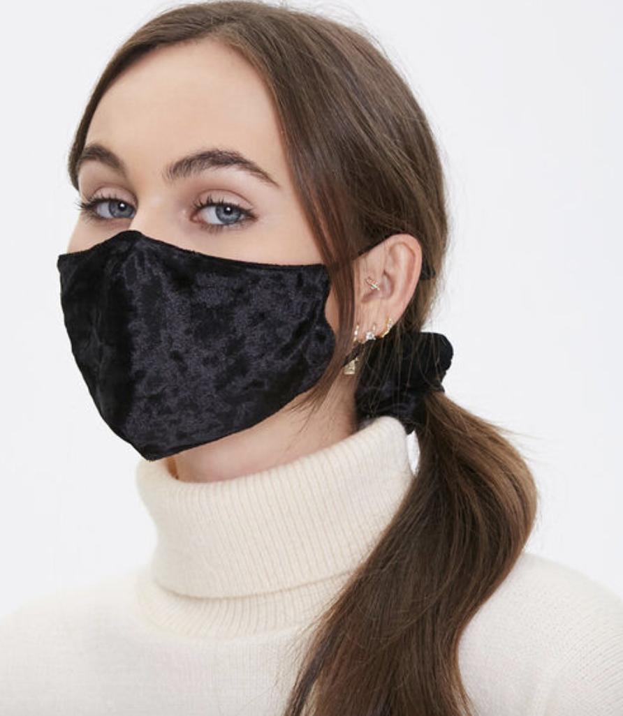 Model in black velvet face mask