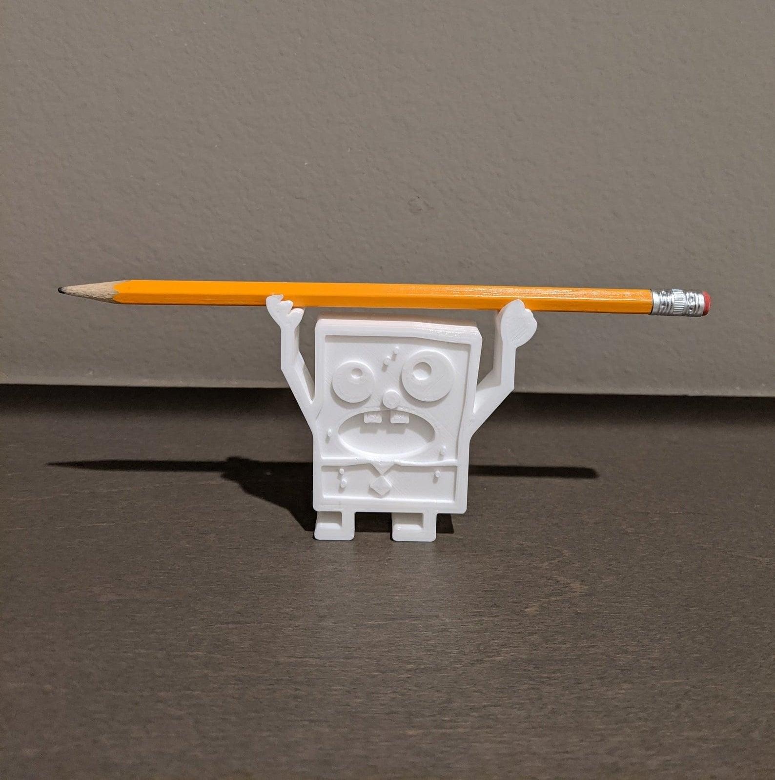 The Doodle Bob holding a pencil