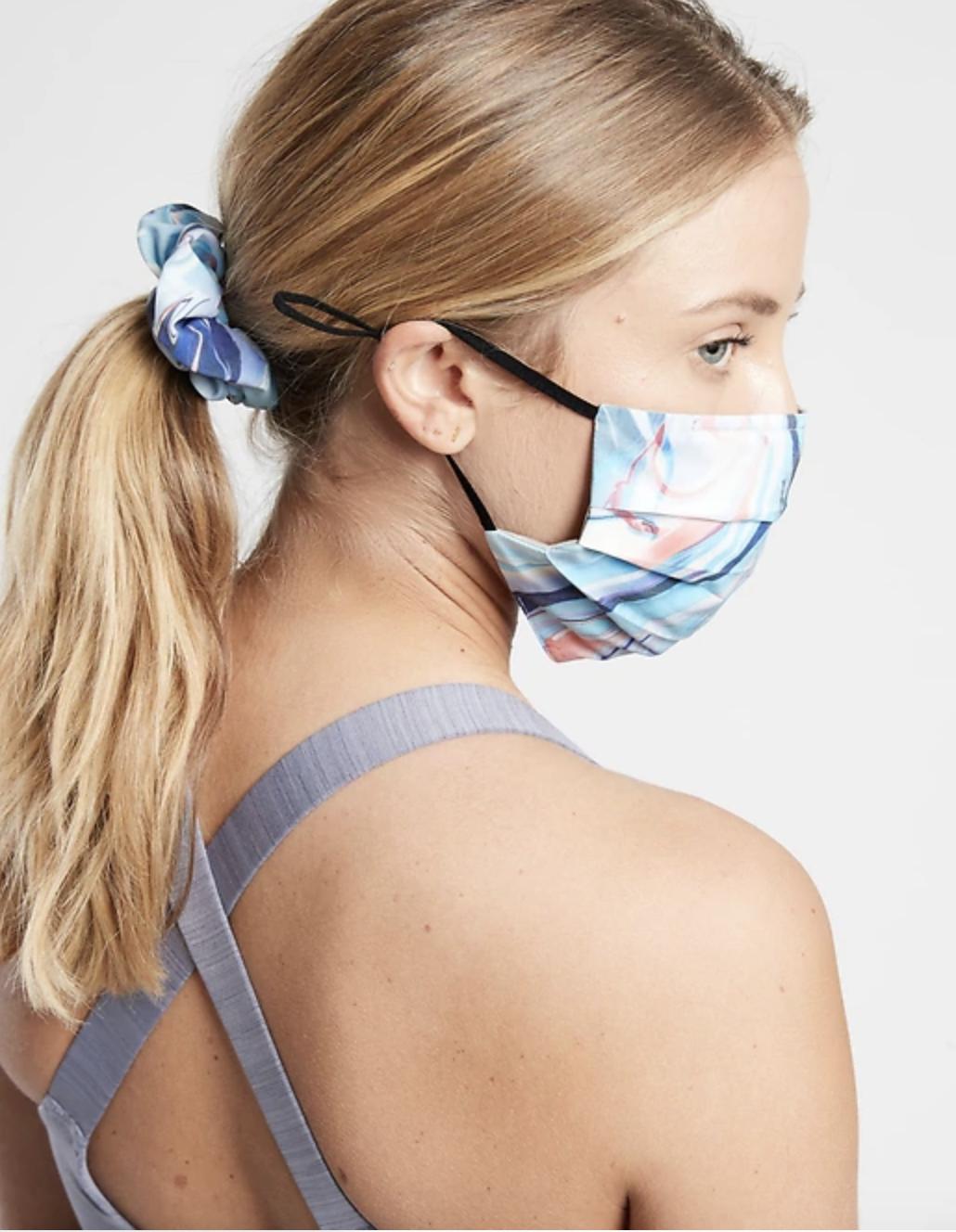 Model in tie dye face mask
