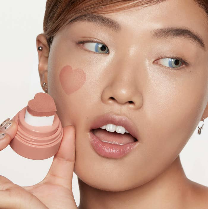 model holds cheeky stamp