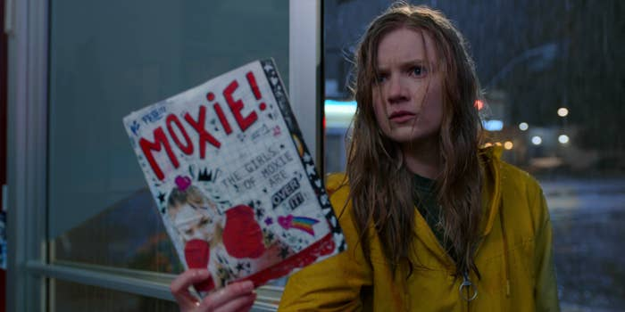 Vivian holding up a copy of the zine