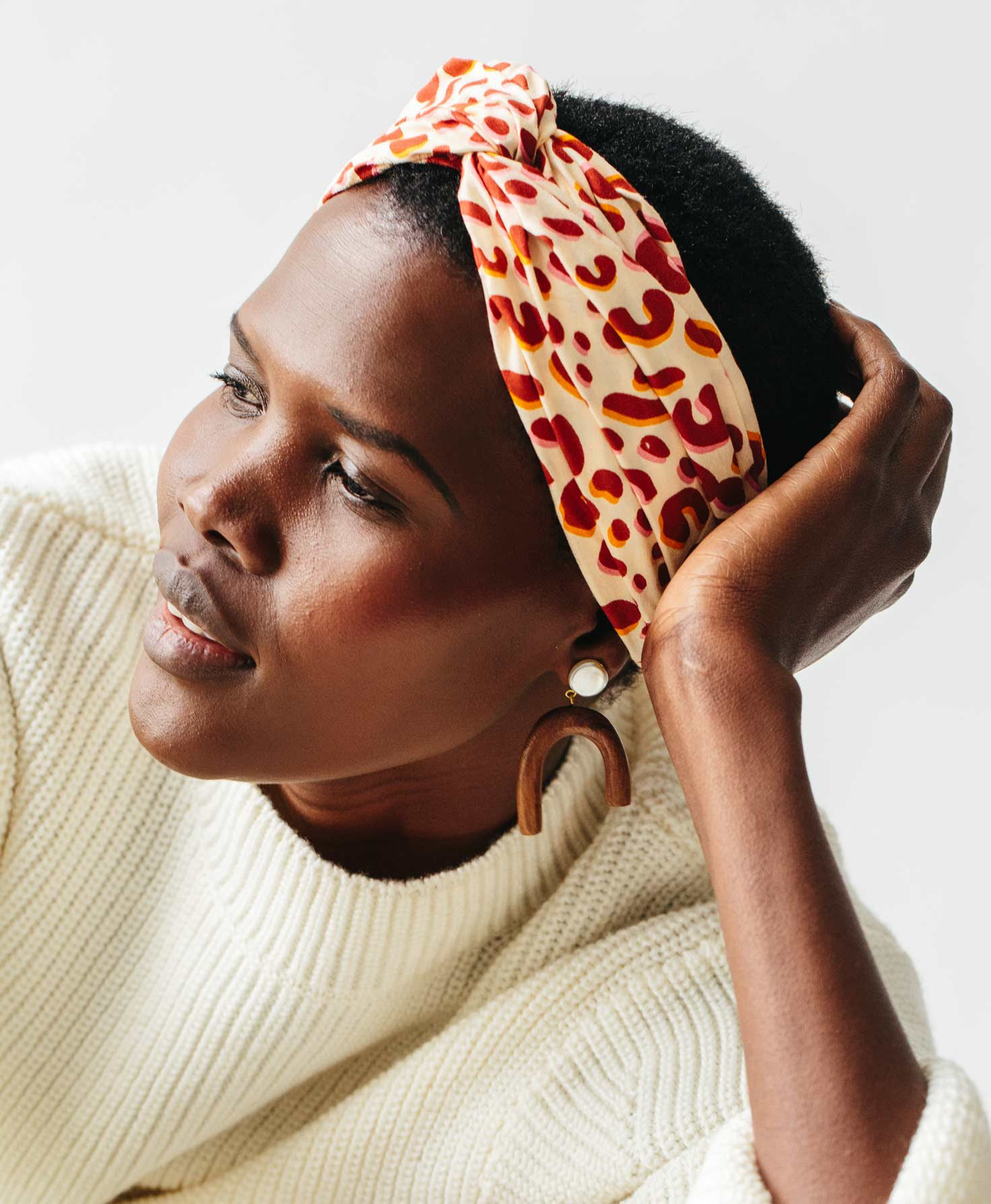 model wearing the white red pink cheetah print knotted headband