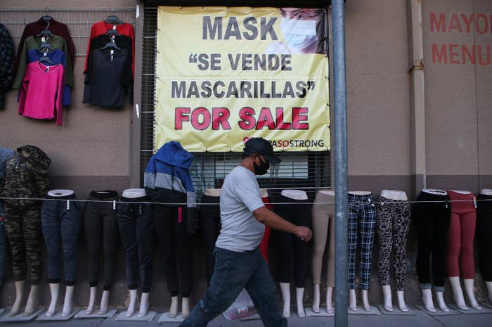 """A storefront shows a sign that reads """"masks for sale"""""""