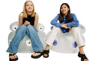 Girls sitting on inflatable furniture
