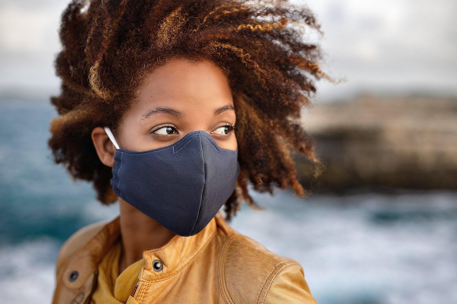 Model in black face mask