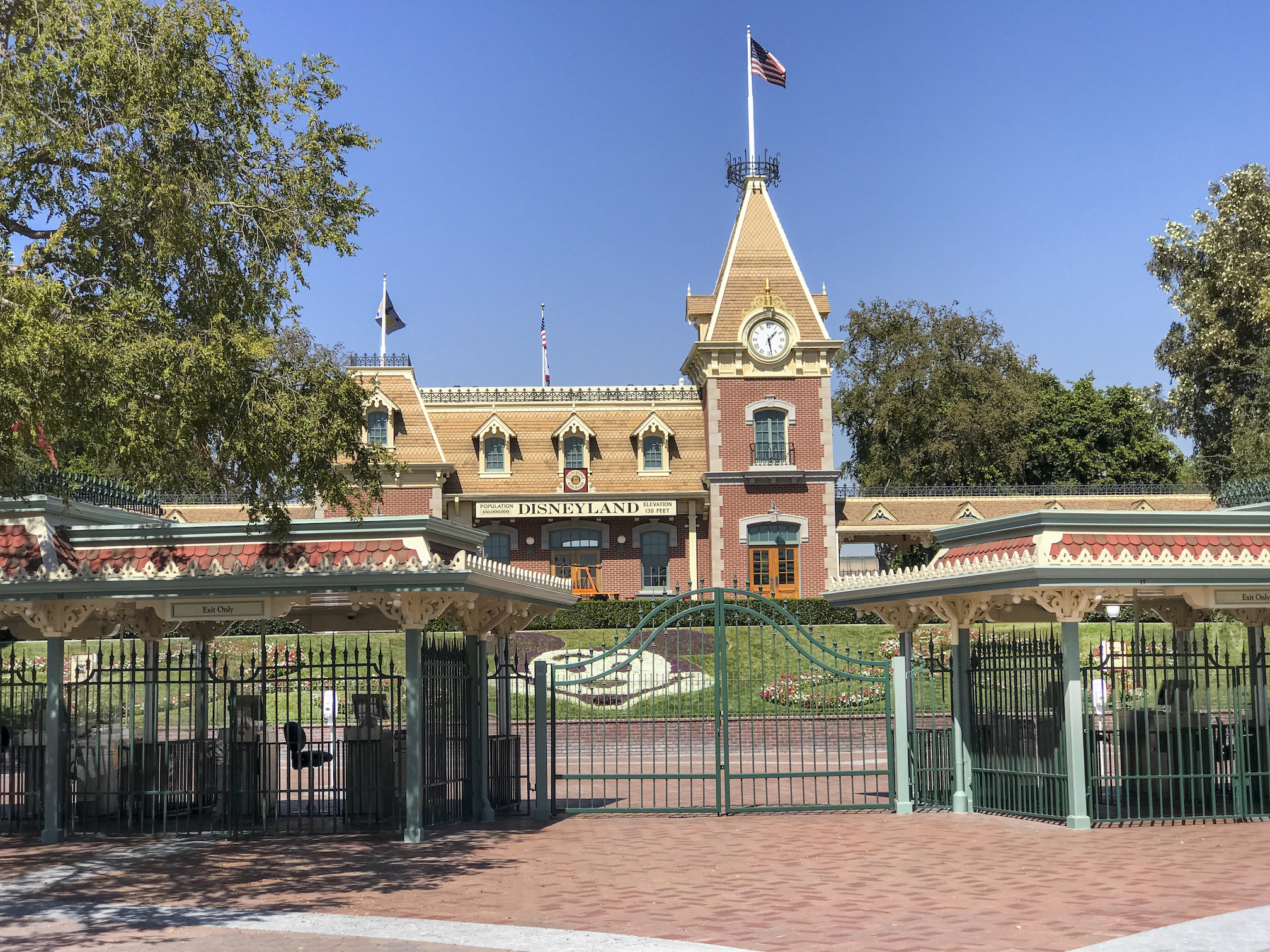 The front of Disneyland's gates closed with the train station in the background