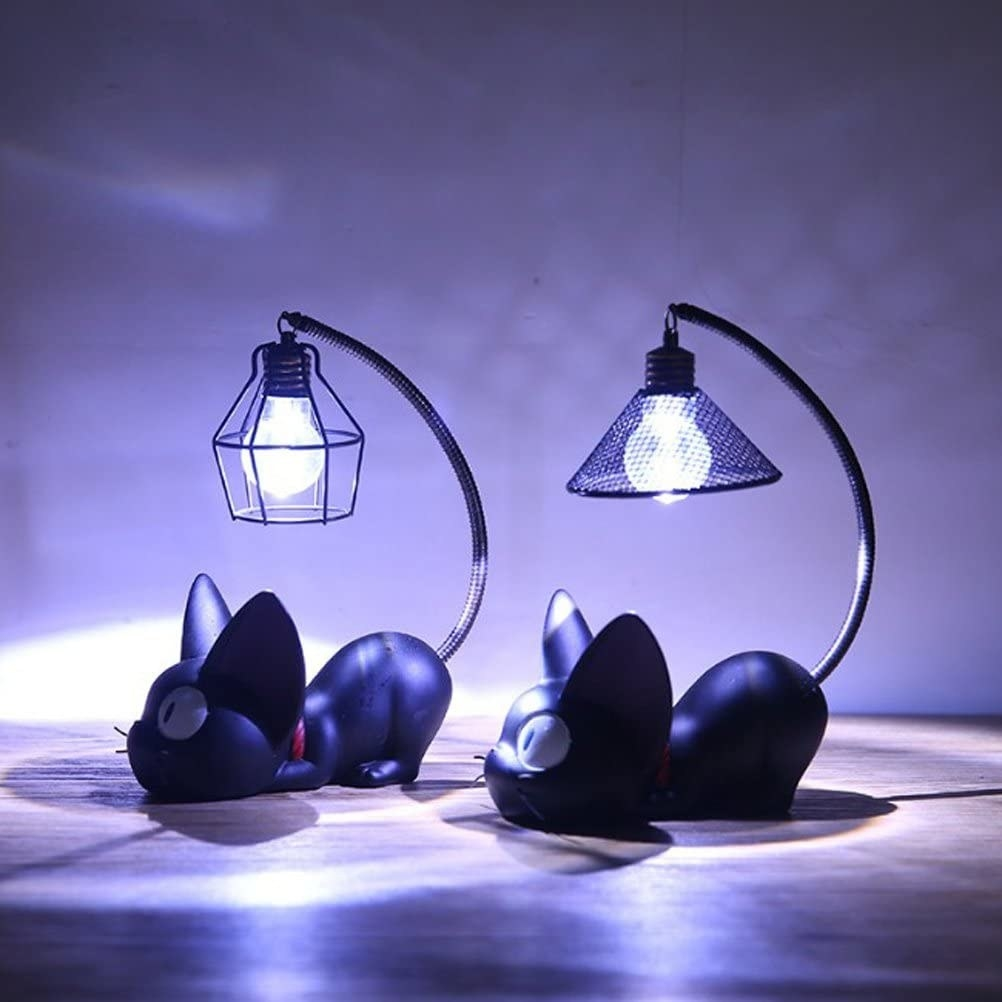 two of the cat-shaped nightlights with bulbs hanging from the cats' tail