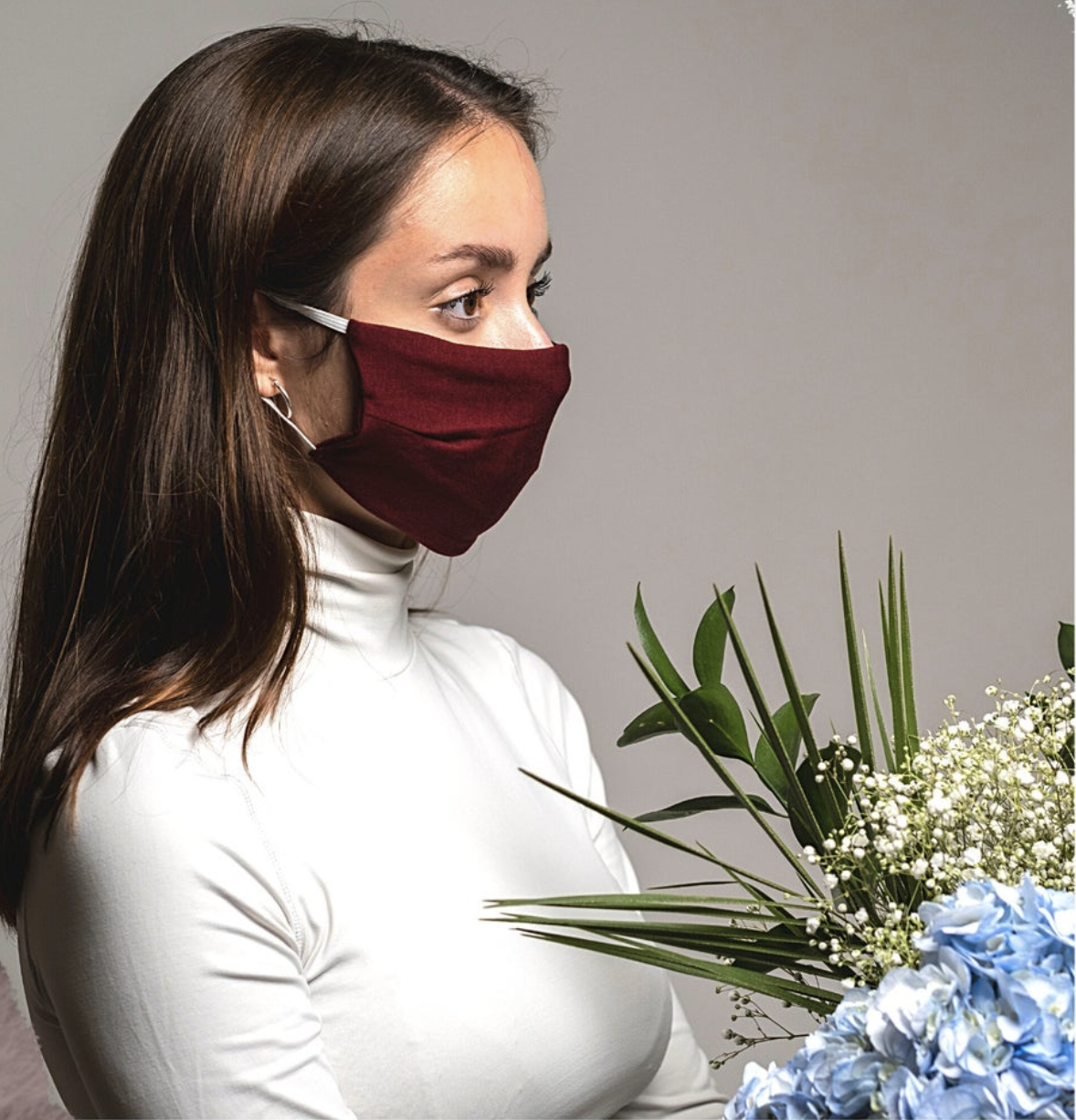 Model in red face mask