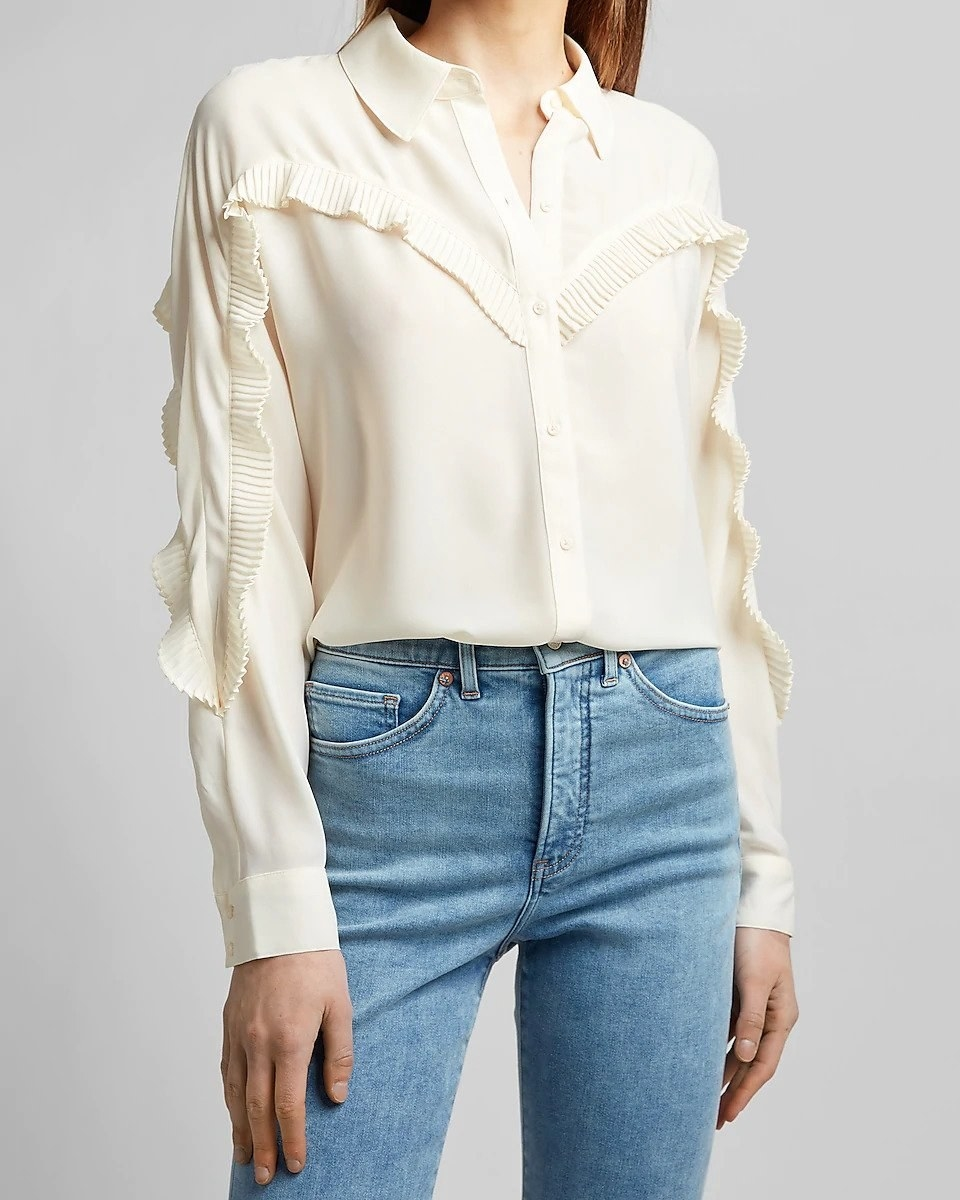 model in white long-sleeve ruffle-front shirt and jeans