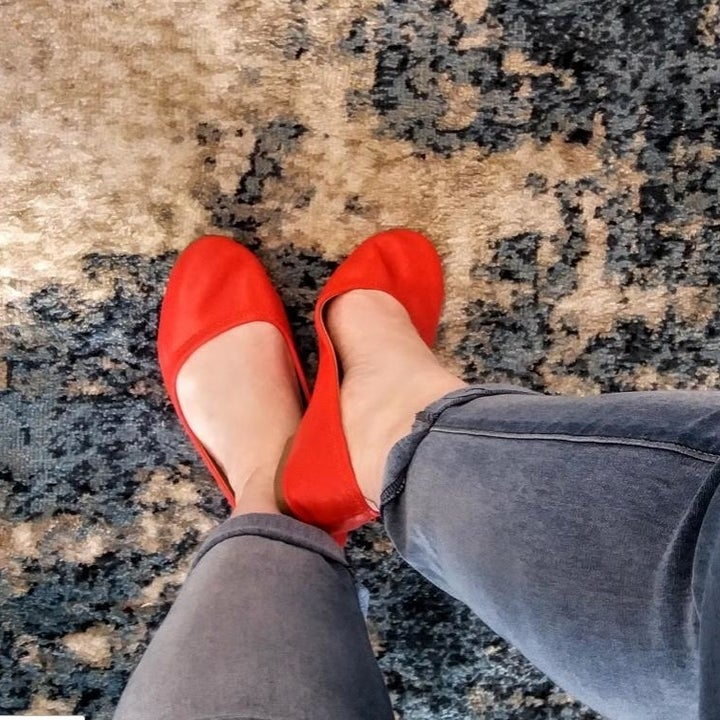 reviewer wearing red flats