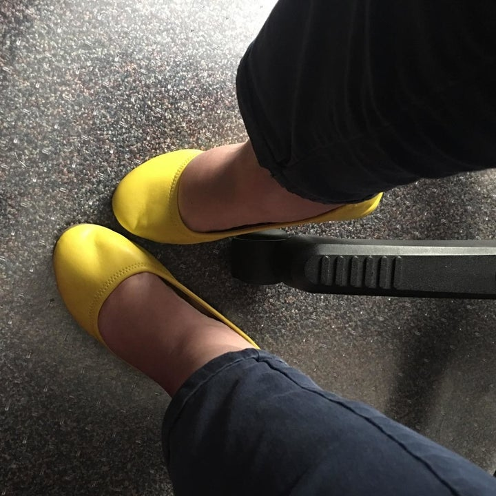 reviewer wearing the flats in yellow