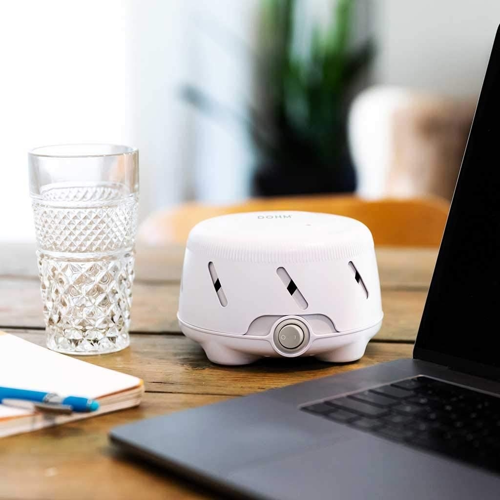 The white noise machine beside a computer