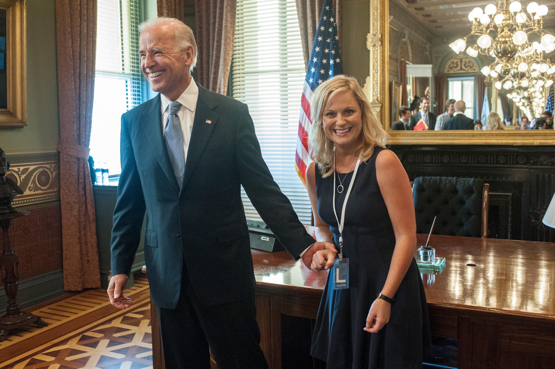 Joe Biden holding Leslie's hand on the show
