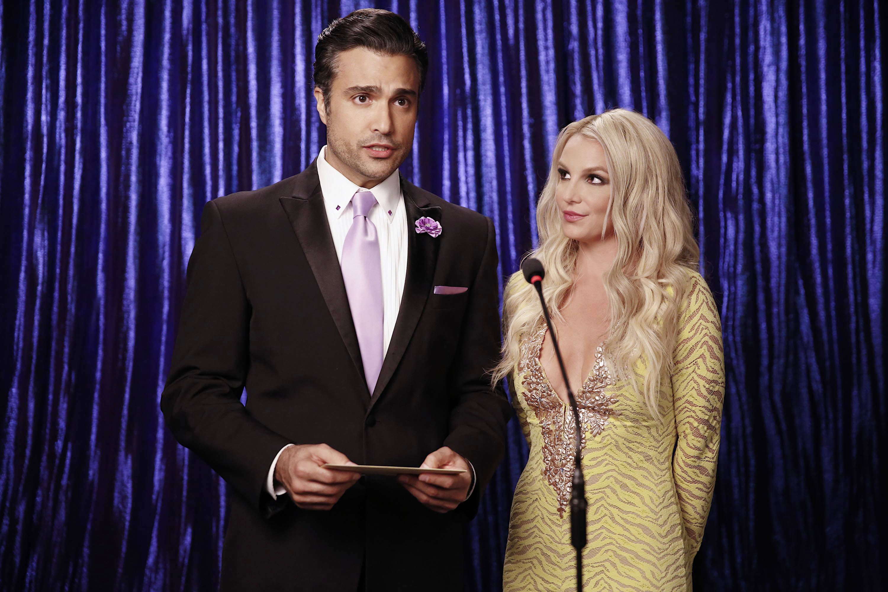 Rogelio presenting next to Britney on the show