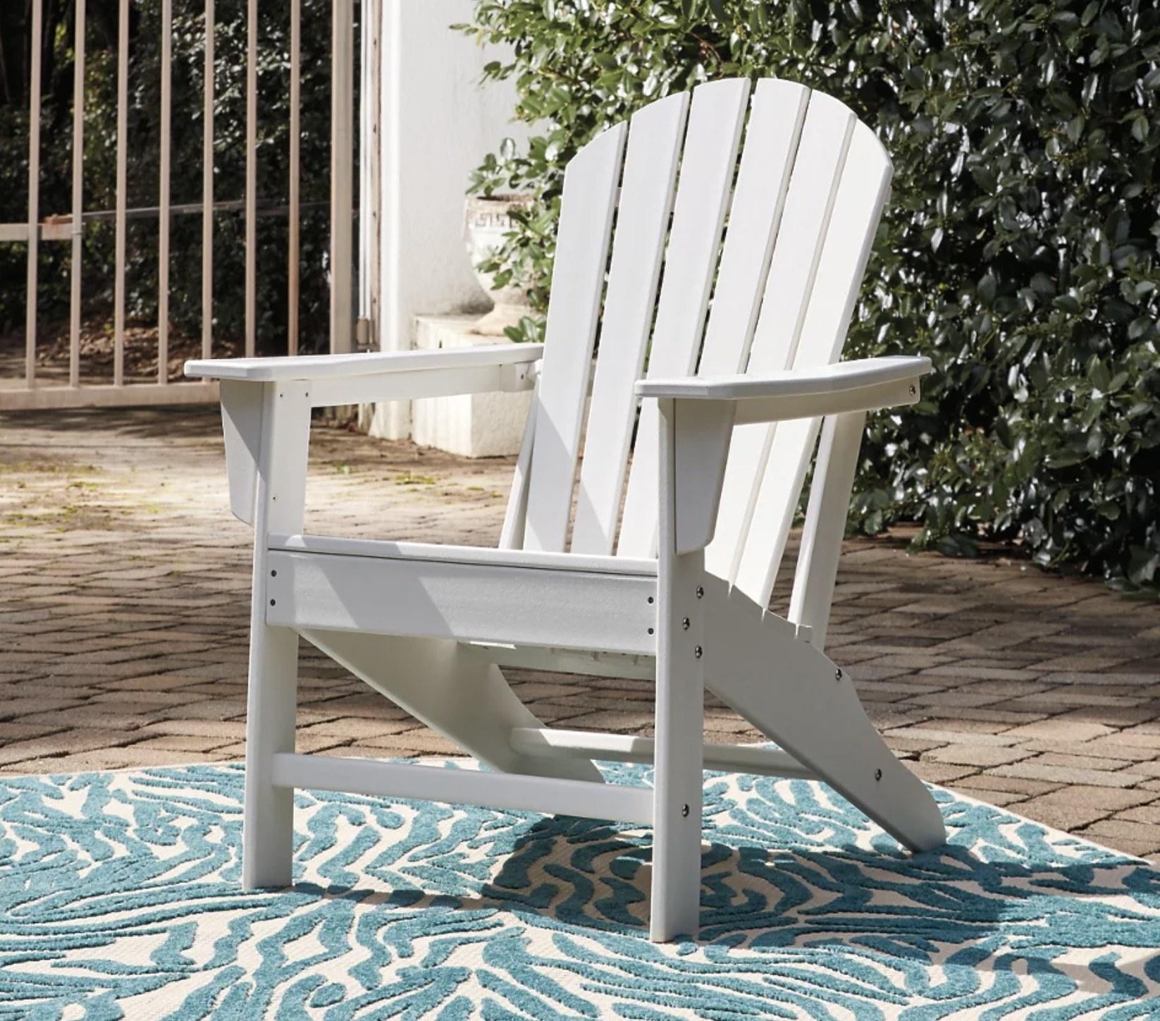 A white Adirondack chair