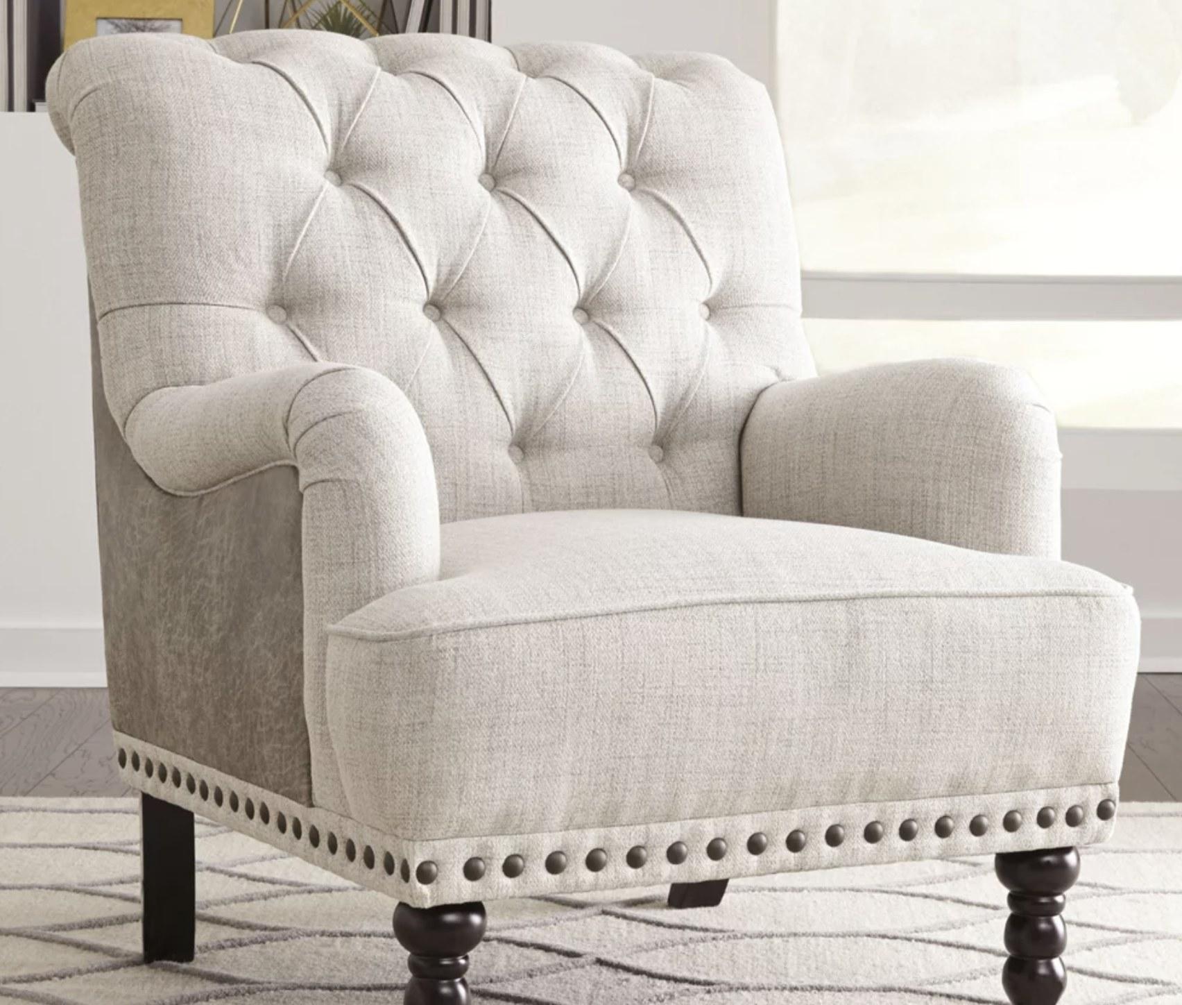 A white tufted chair