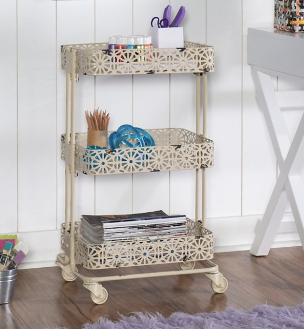 A cream metal tiered cart