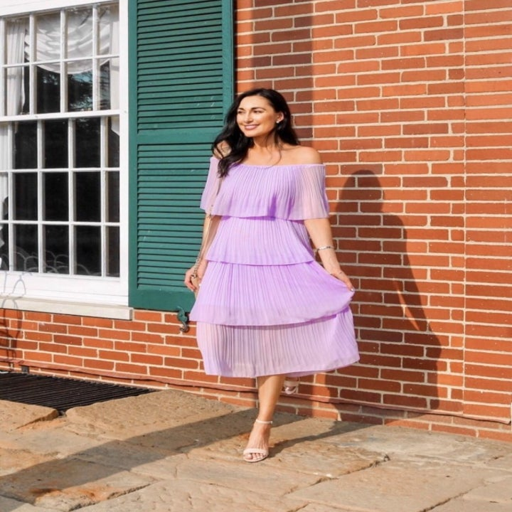a reviewer wearing the dress in lilac with neutral heels