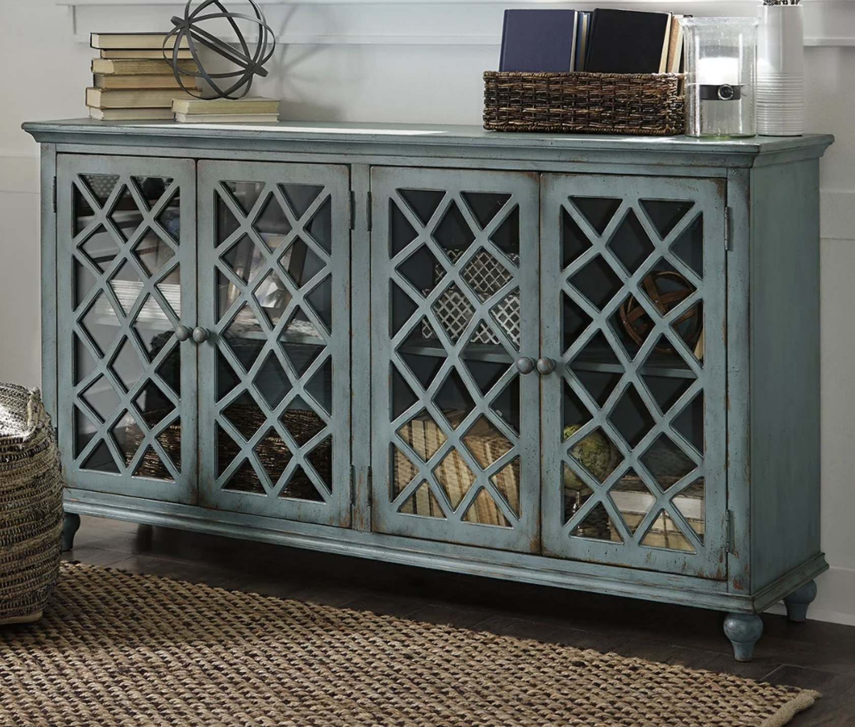 A weathered blue wood cabinet