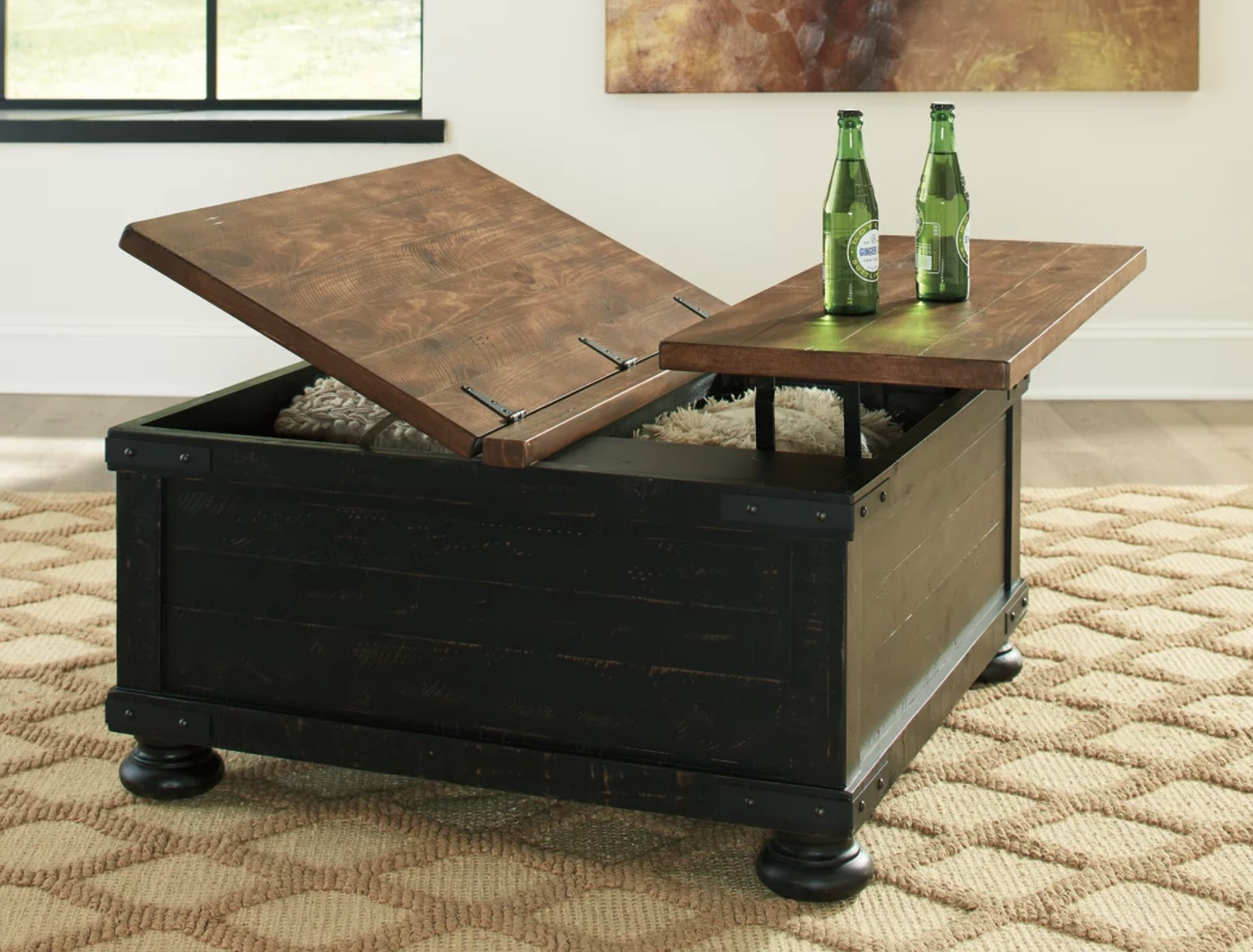 The black coffee table with lift top storage space