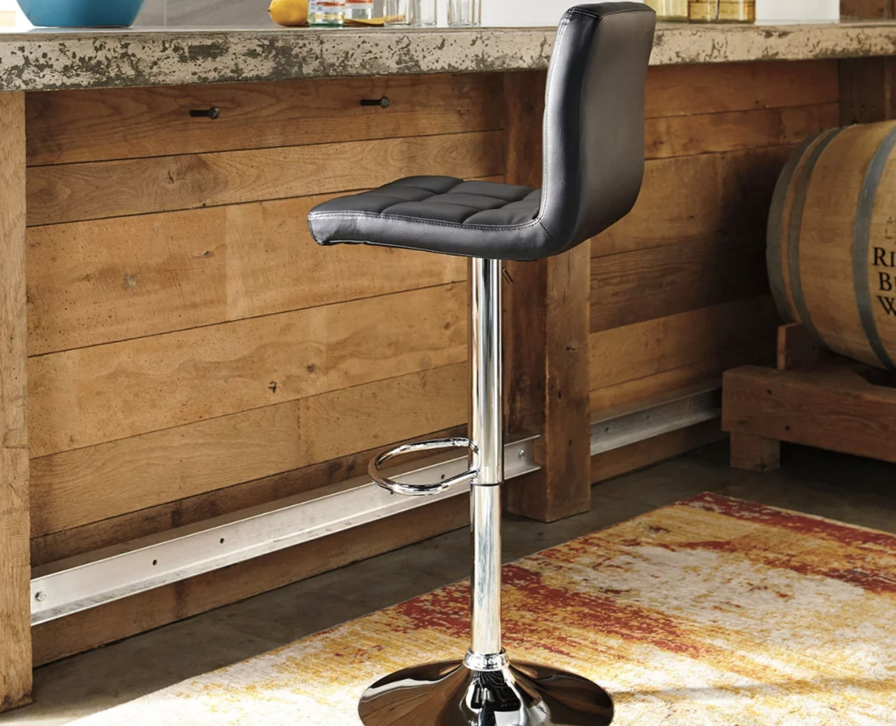 The black leather and chrome bar stool
