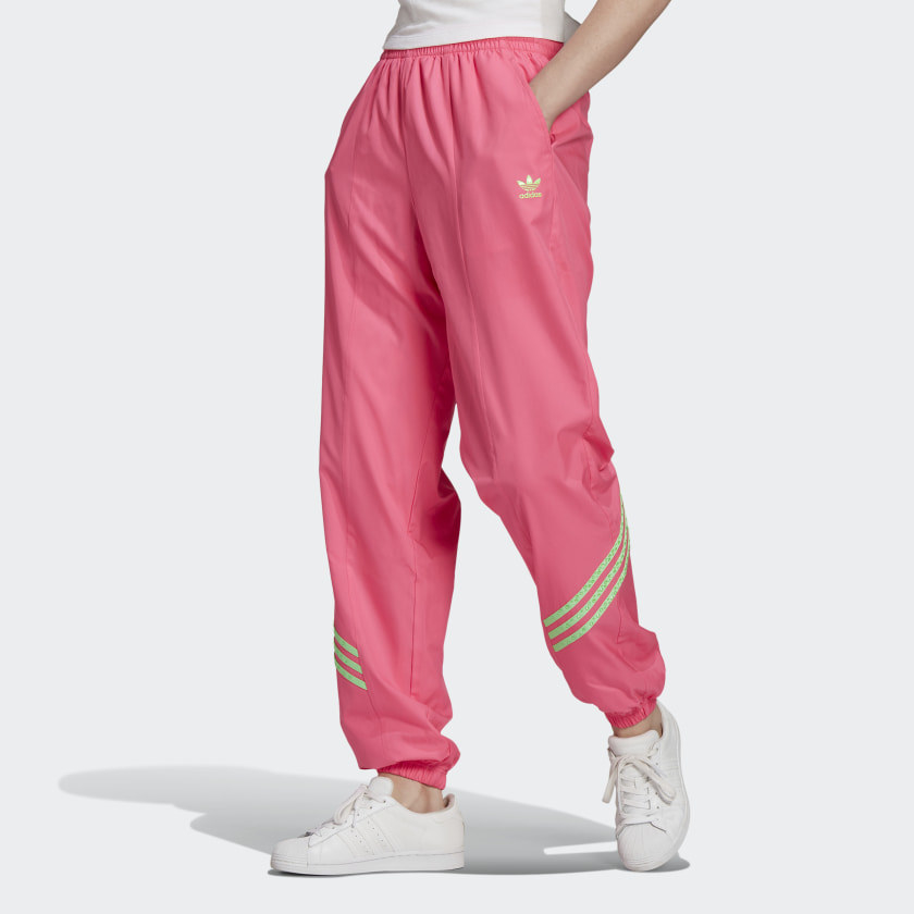 Model wearing track pants that cuff at the ankle