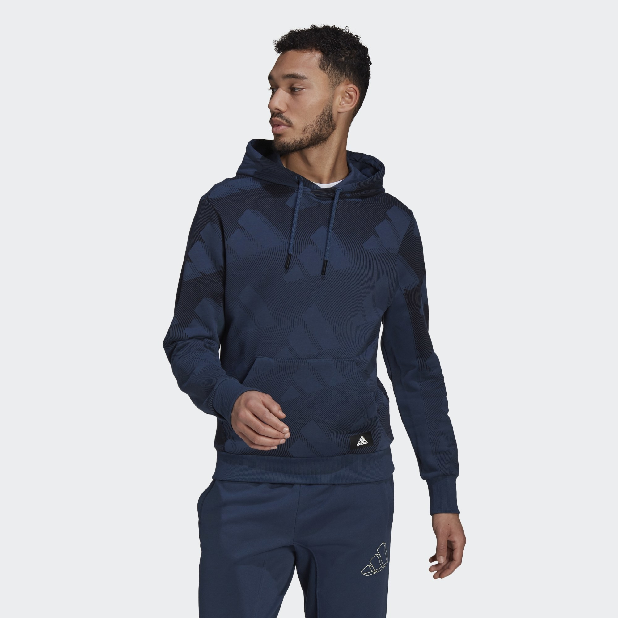 Model wearing dark blue hoodie