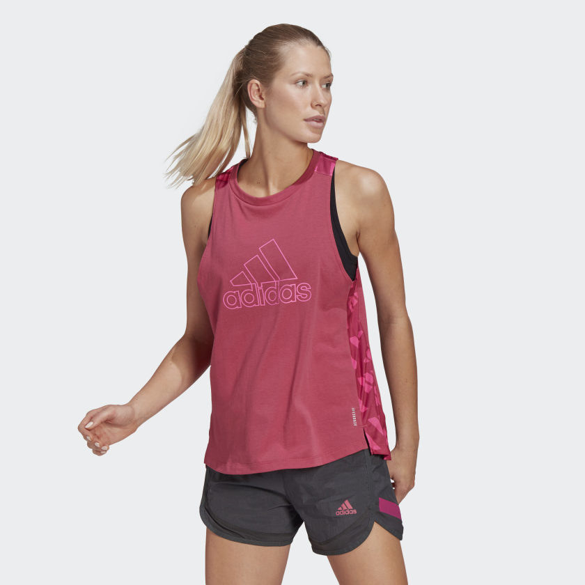 Model wearing pink tank with pink outlined logo