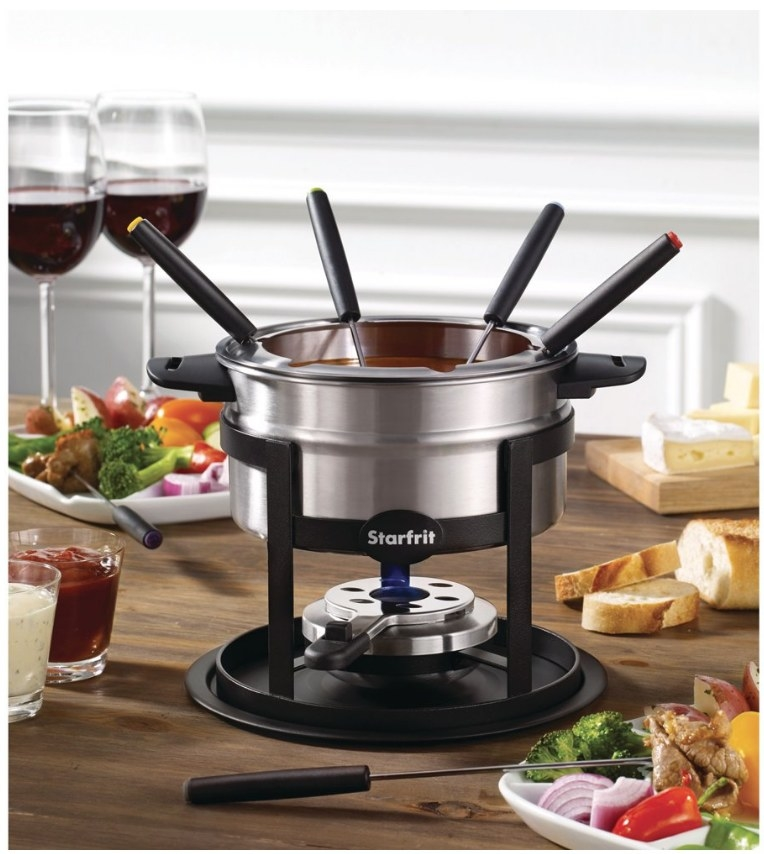 A fondue set with 6 stainless steel forks