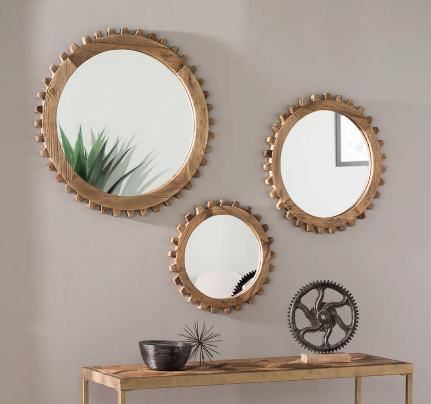 Three mirrors with a wood frame