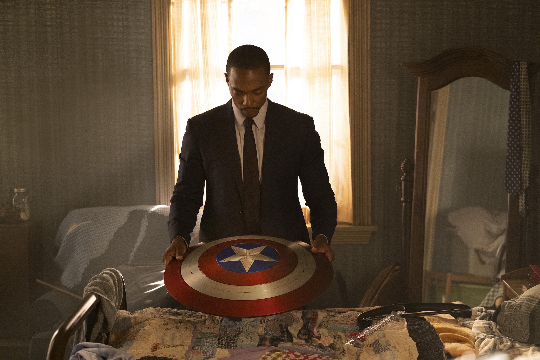 Sam Wilson holding the Captain America shield