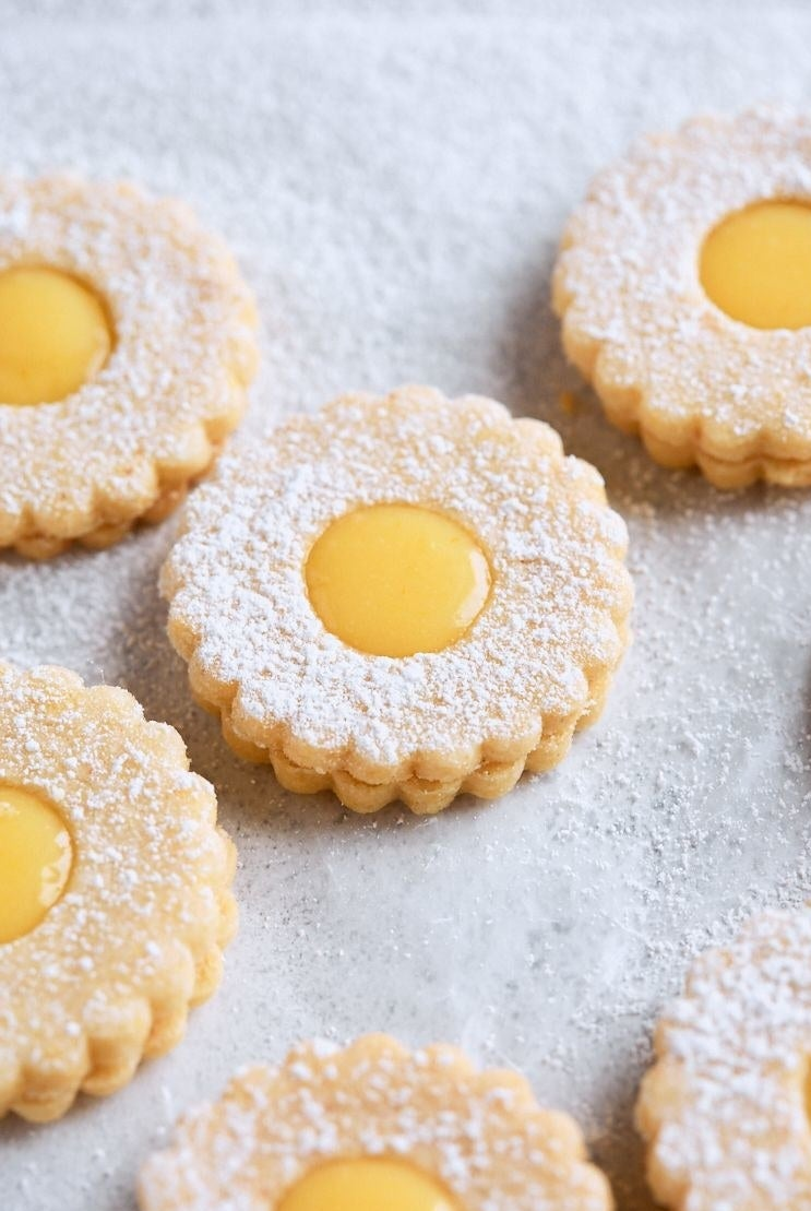Lemon linzer tart cookies with powdered sugar.