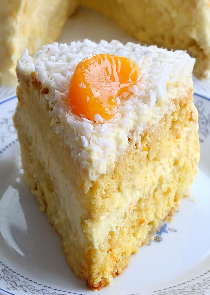 A slice of orange coconut cake.