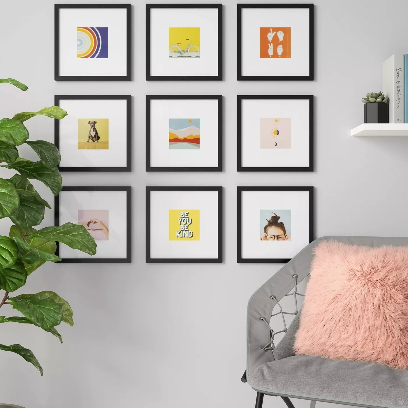 The square, black frames with white photo mats