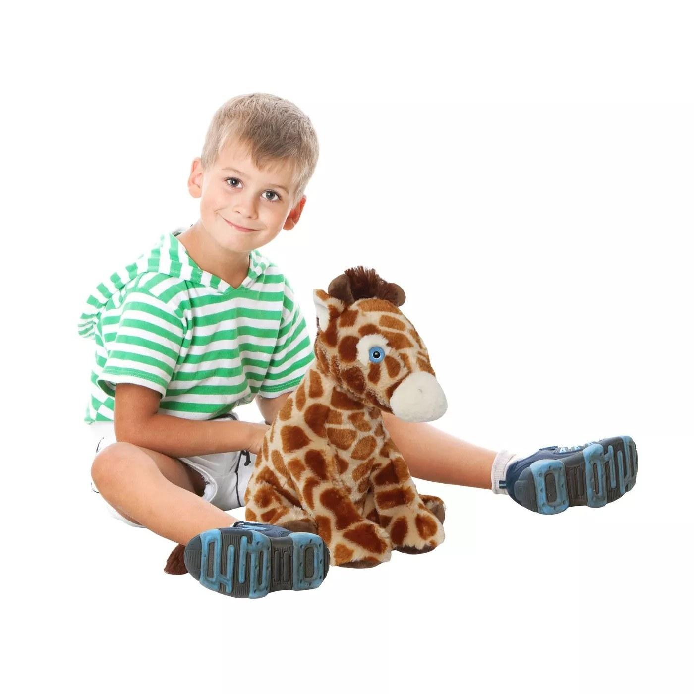 A child with the plush giraffe